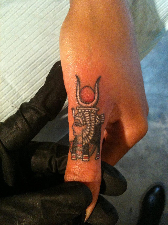 A very small Hathor finger tattoo by LazerLiz.