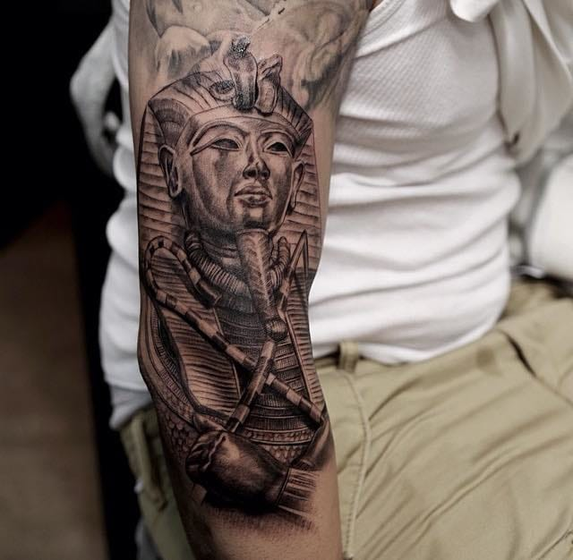 Tutankhamun by Nico Negron, an epic black and grey tattoo.