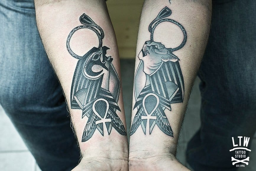 Horus and Sekhmet by Rodrigo DC. The ankh under them is the symbol of life and a lucky charm.