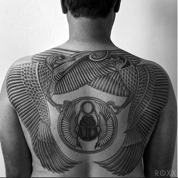 Winged gods surrounding a beetle, another sacred and lucky symbol. Great backpiece by Roxx.