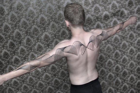 Spotlight: From Dots to Lines - Tattoos by Chaim Machlev