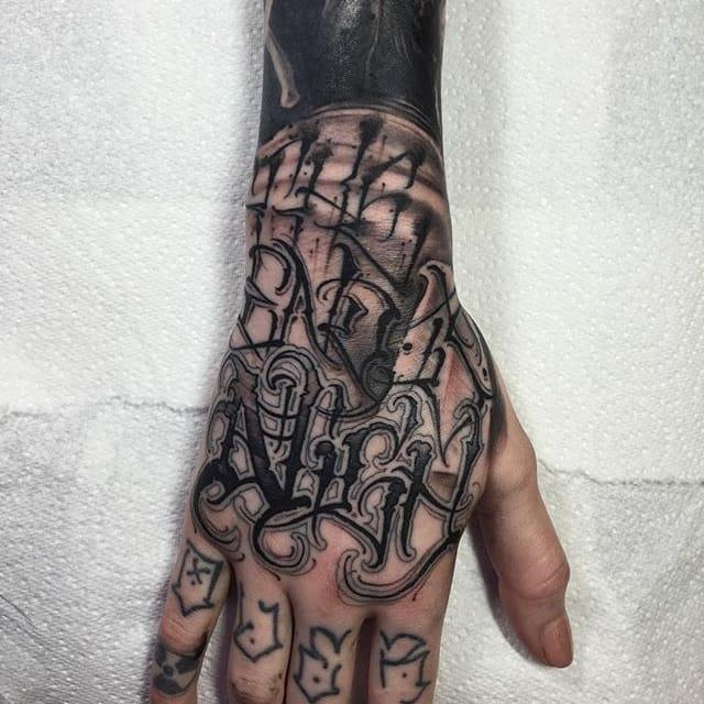 Anrijs Straume's Distinctive Blackwork Lettering Tattoos