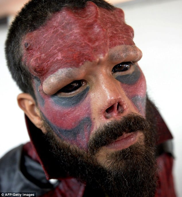 Real-life villain: Henry Damon, 37, from Caracas, Venezuela, has had his nose removed as part of his facial transformation into a real-life version of Marvel villain Red Skull