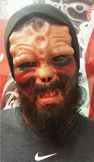 Final steps: After his nose healed and his forehead bulked up, Mr Damon started adding red and black tattoos to his face to get the right Red Skull look