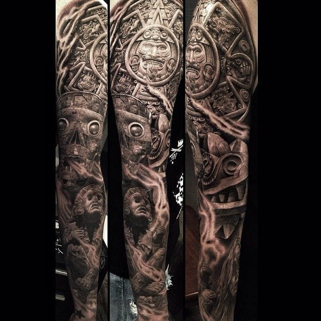 Aztec tattoos covering the whole sleeve look amazing. Tattoo by Greg Nicholson! #aztec #aztectattoo #gregnicholson