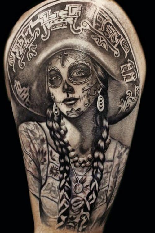 Traditional La Catrina tattoos are wearing a hat, here by Steve Soto.