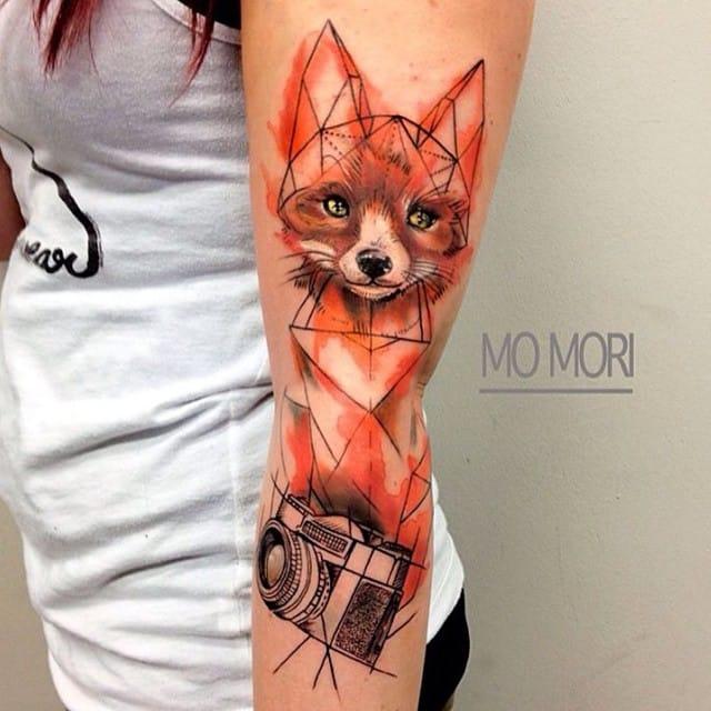 Interesting geometric tattoo by Mo Mori.