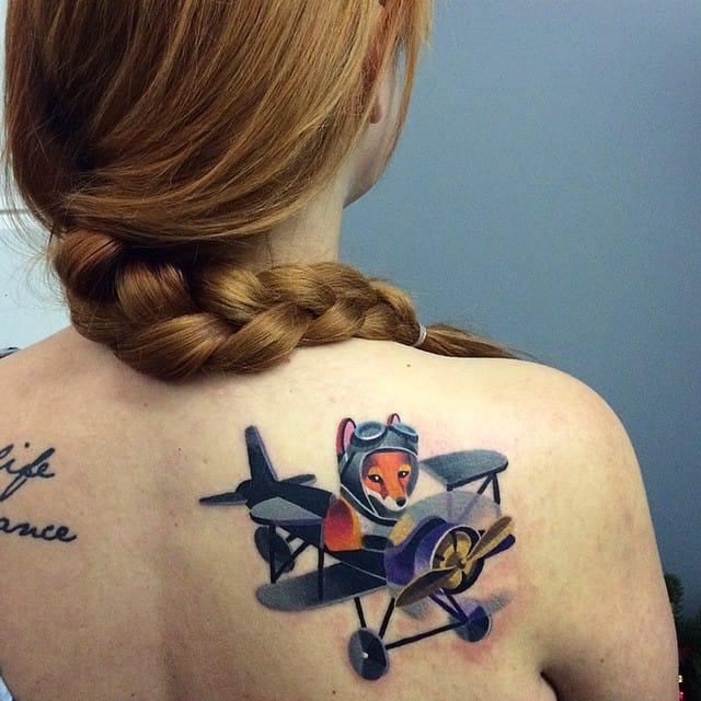 That's one fun aviator fox tattoo by Sasha Unisex!