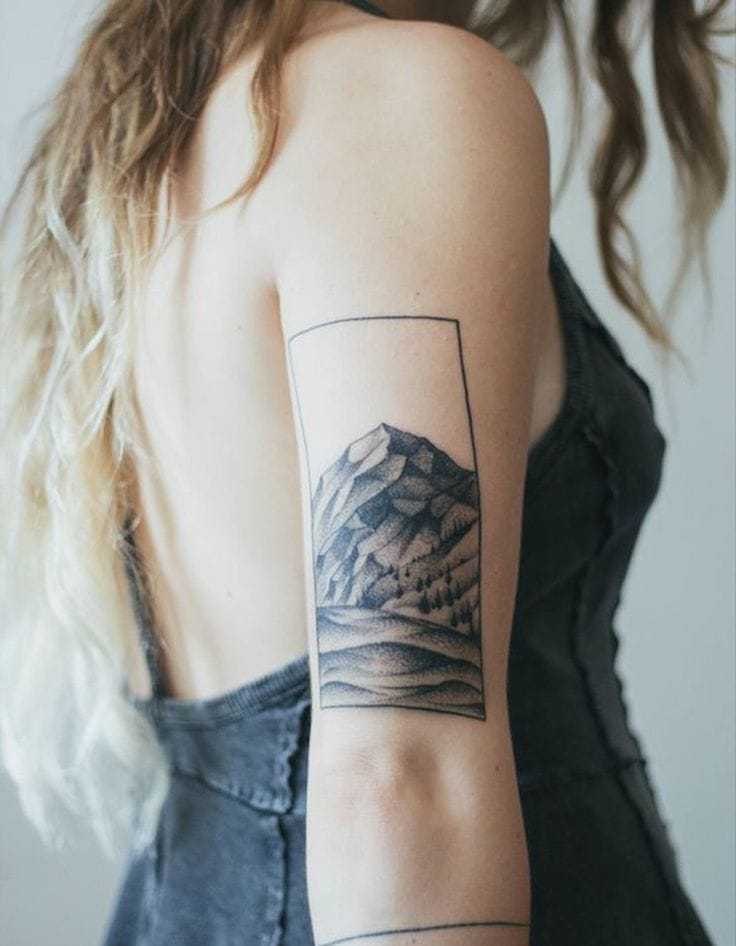 An elegant mountain tattoo is both artistic, subtle and mysterious. Could you credit the artist?