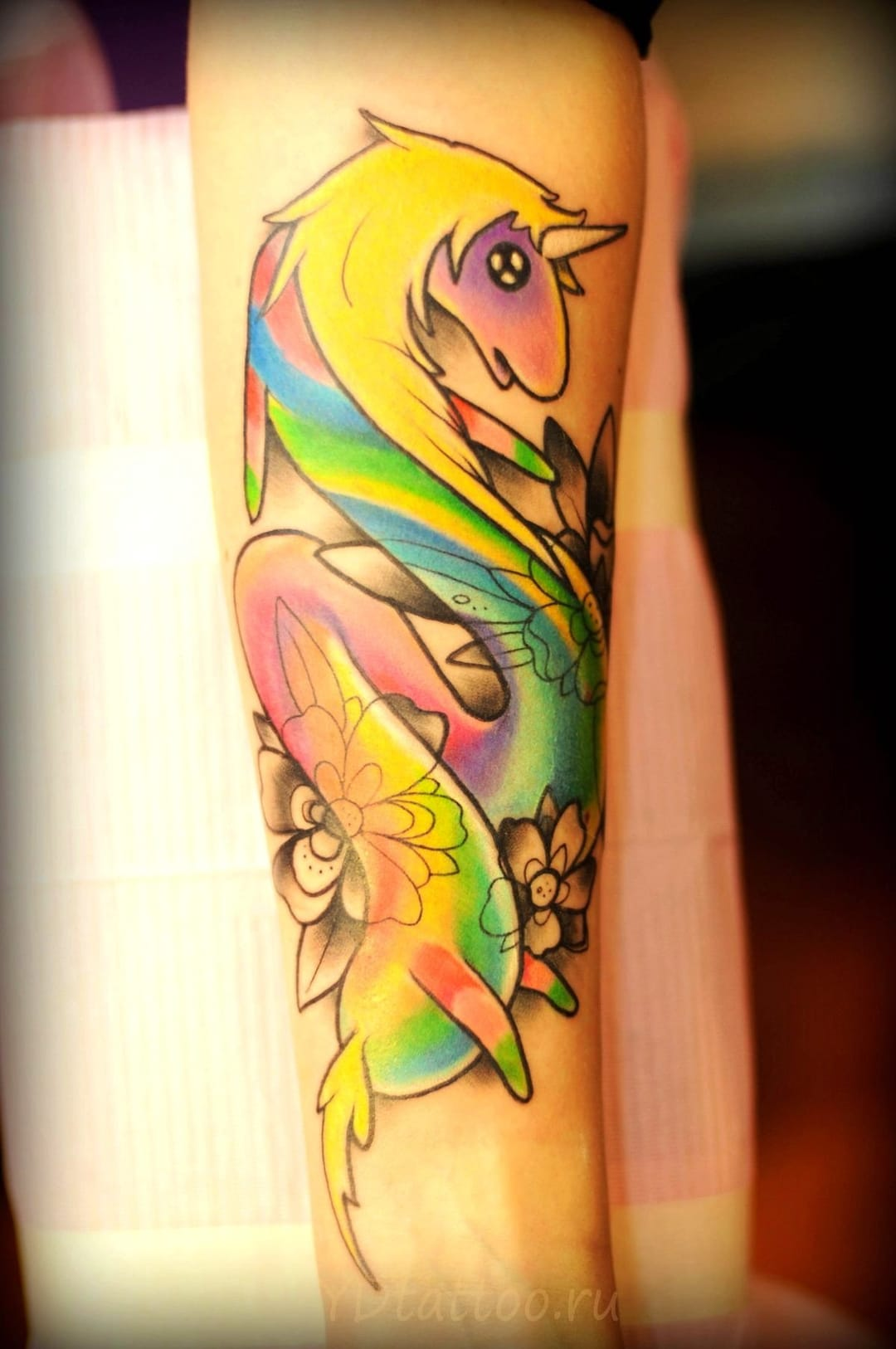 Rainbow unicorn tattoo