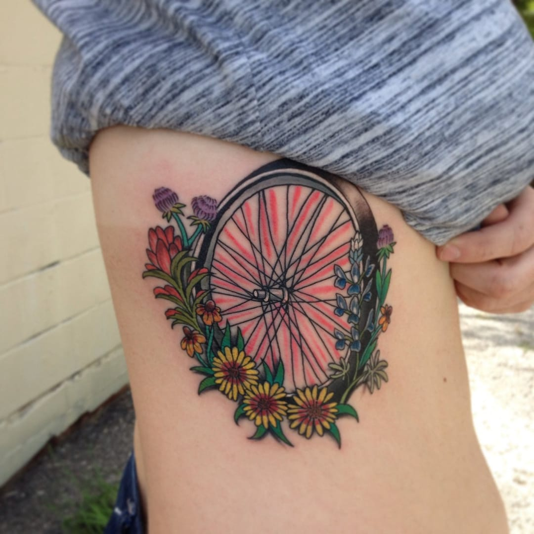 wheel tattoo with flowers