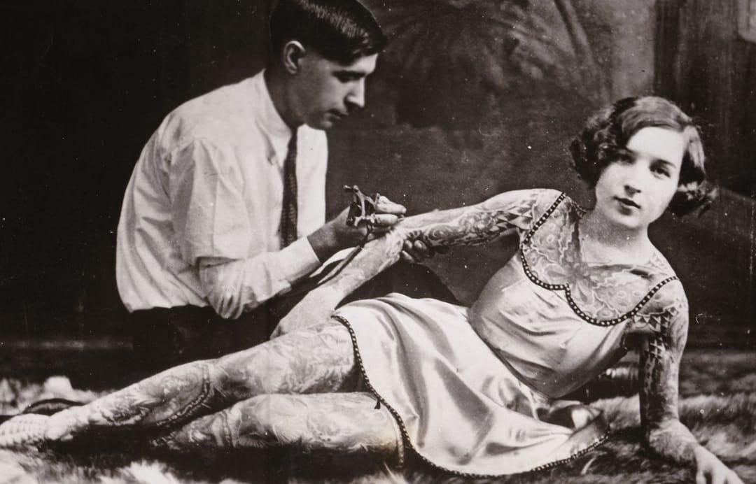 woman getting tattooed