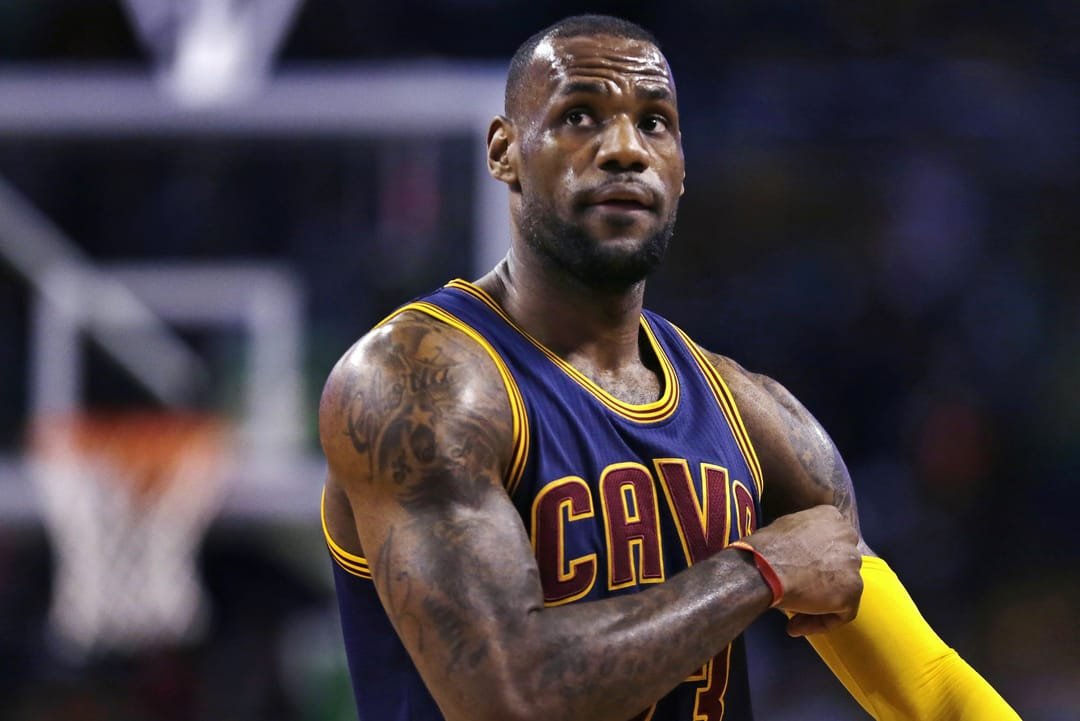 Cleveland Cavaliers forward LeBron James pulls up his sleeve while facing the Boston Celtics in the first quarter of a first-round NBA playoff basketball game in Boston, Thursday, April 23, 2015. (AP Photo/Charles Krupa)