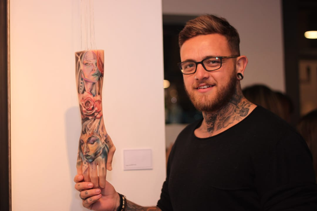 Tattoo artist David Brace with his artwork on synthetic limb.