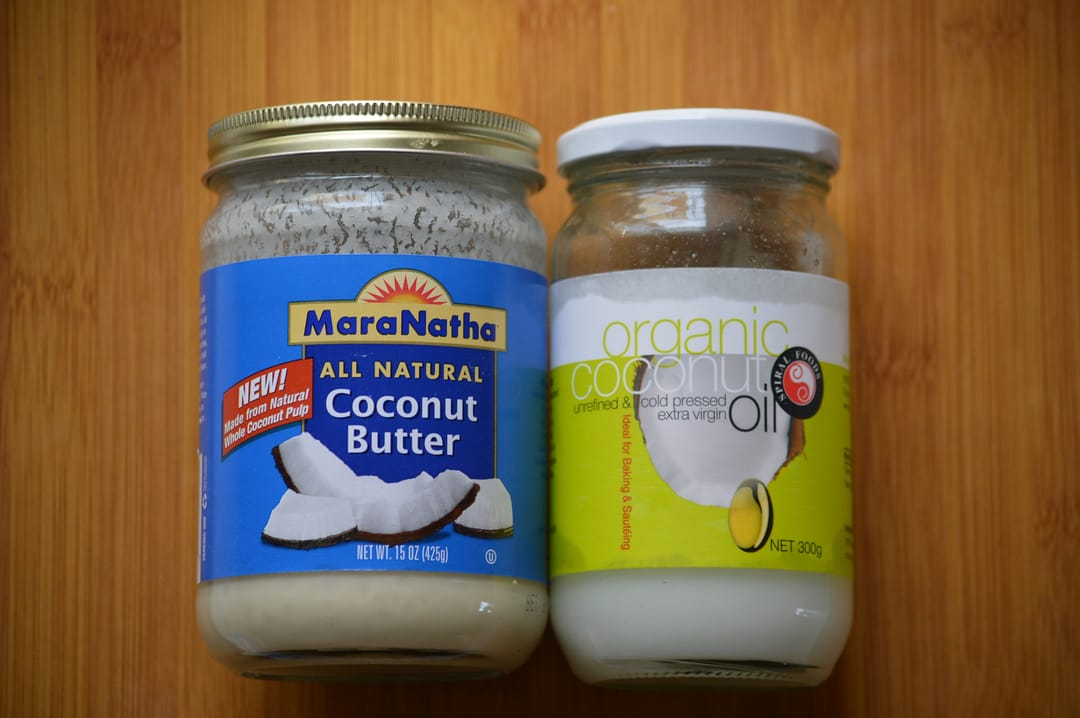 Coconut butter and coconut oil are not interchangeable. The butter contains the actual fruit of the coconut. You want coconut oil which is smooth and will absorb into your skin.