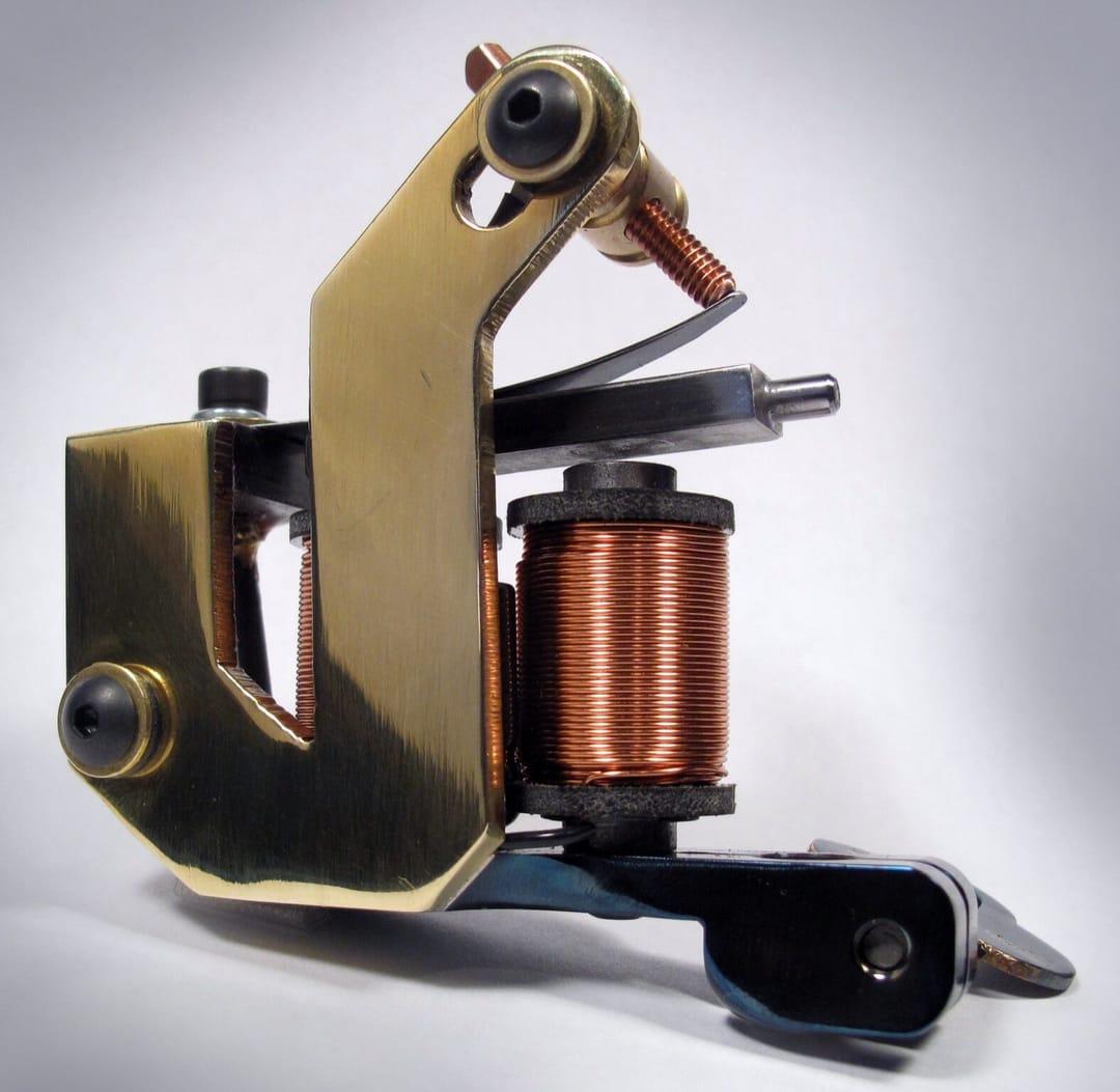 The Hammer - hand cut brass by Tim Hendricks.