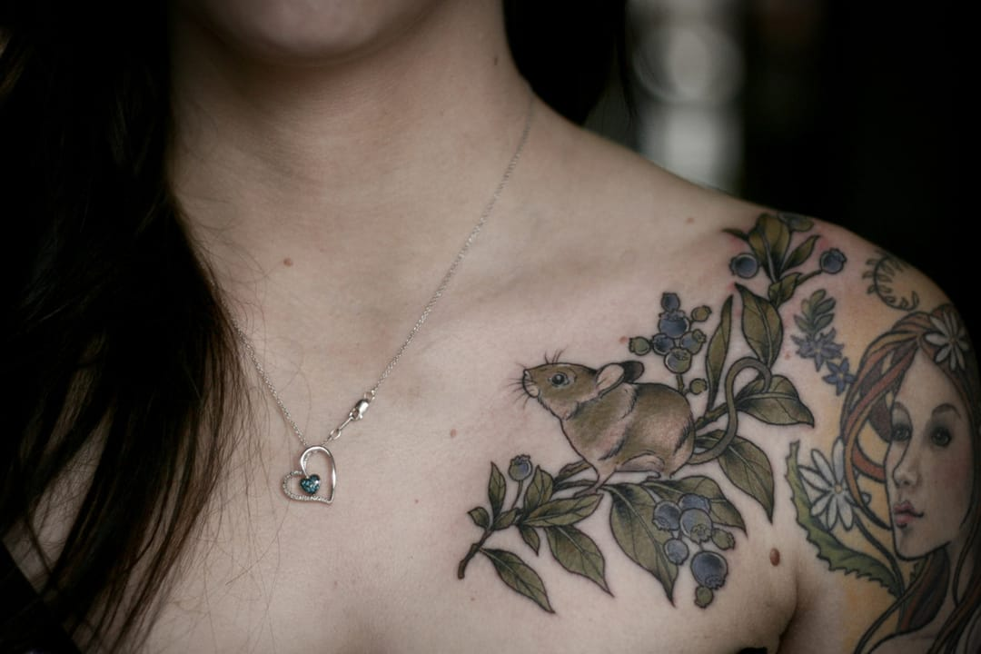 Mouse and berries shoulder tattoo.