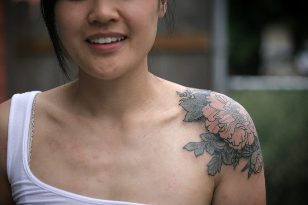 Flower shoulder tattoo.