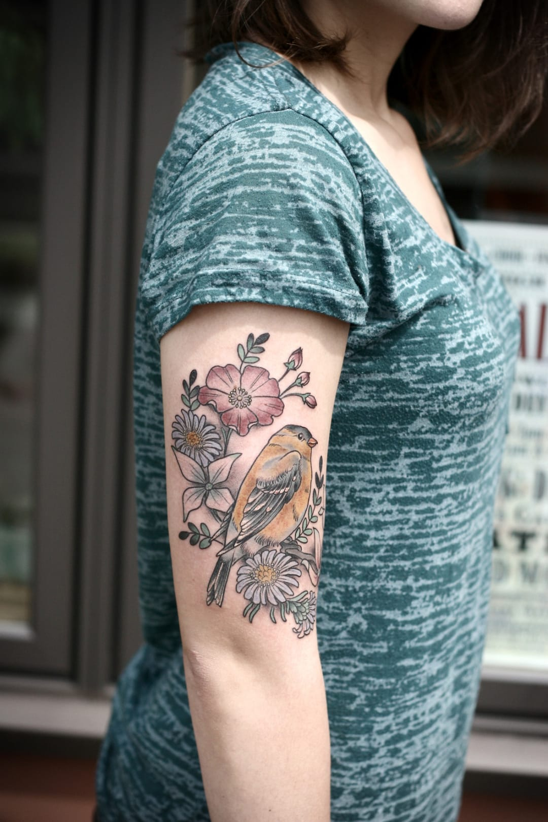 Bird and flowers tattoo.