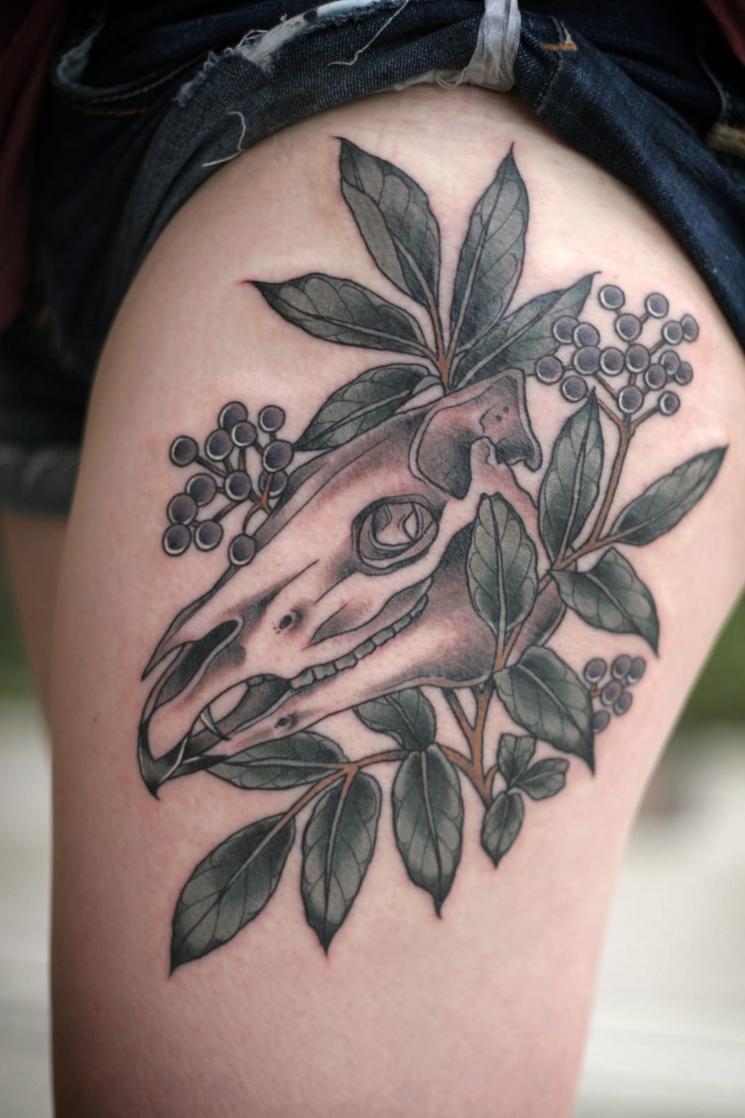 Skull and flowers tattoo