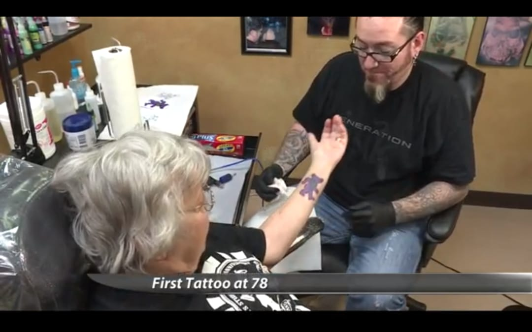 Juneby takes a look at her new tattoos, still frame of the KFYR video
