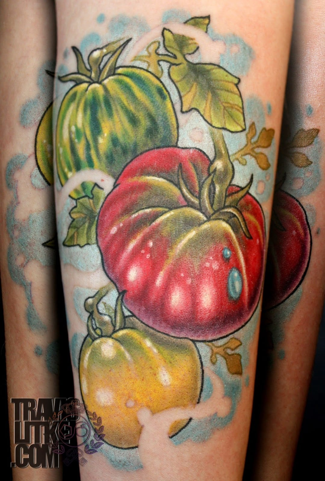 Colorful tomato tattoo by Travis Litke
