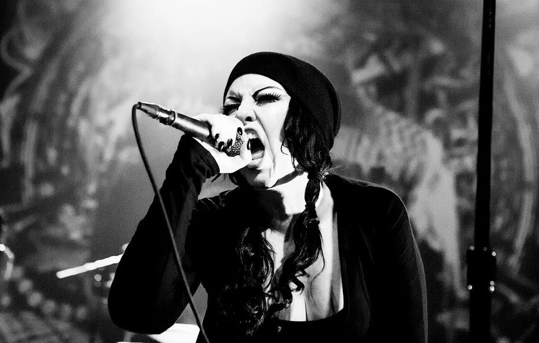Photo by Andy Keilen of Rolling Stone magazine of Tairrie B performing 2015 with metal supergroup Teenage Time Killers