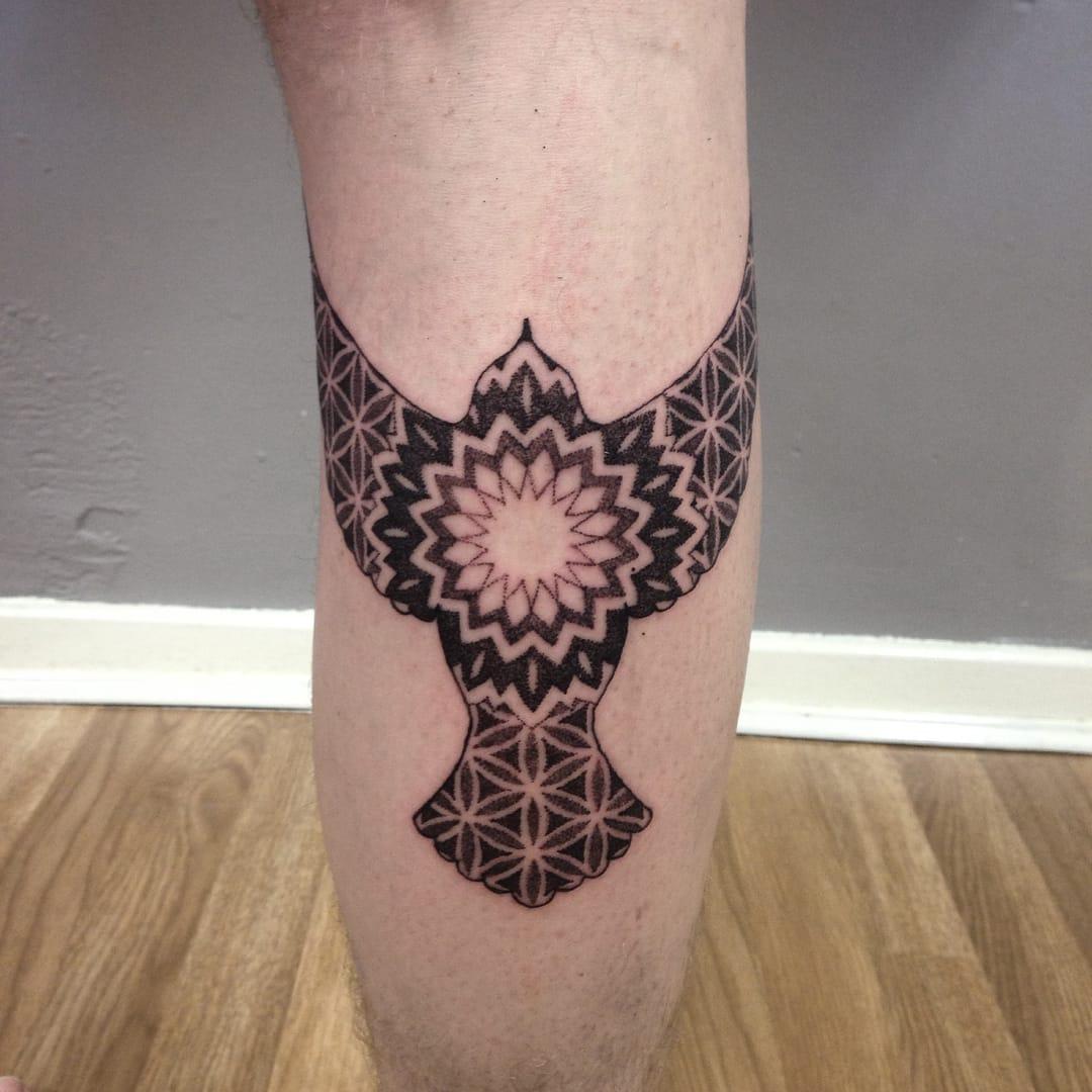 Mandala bird tattoo by Shaun Williams.