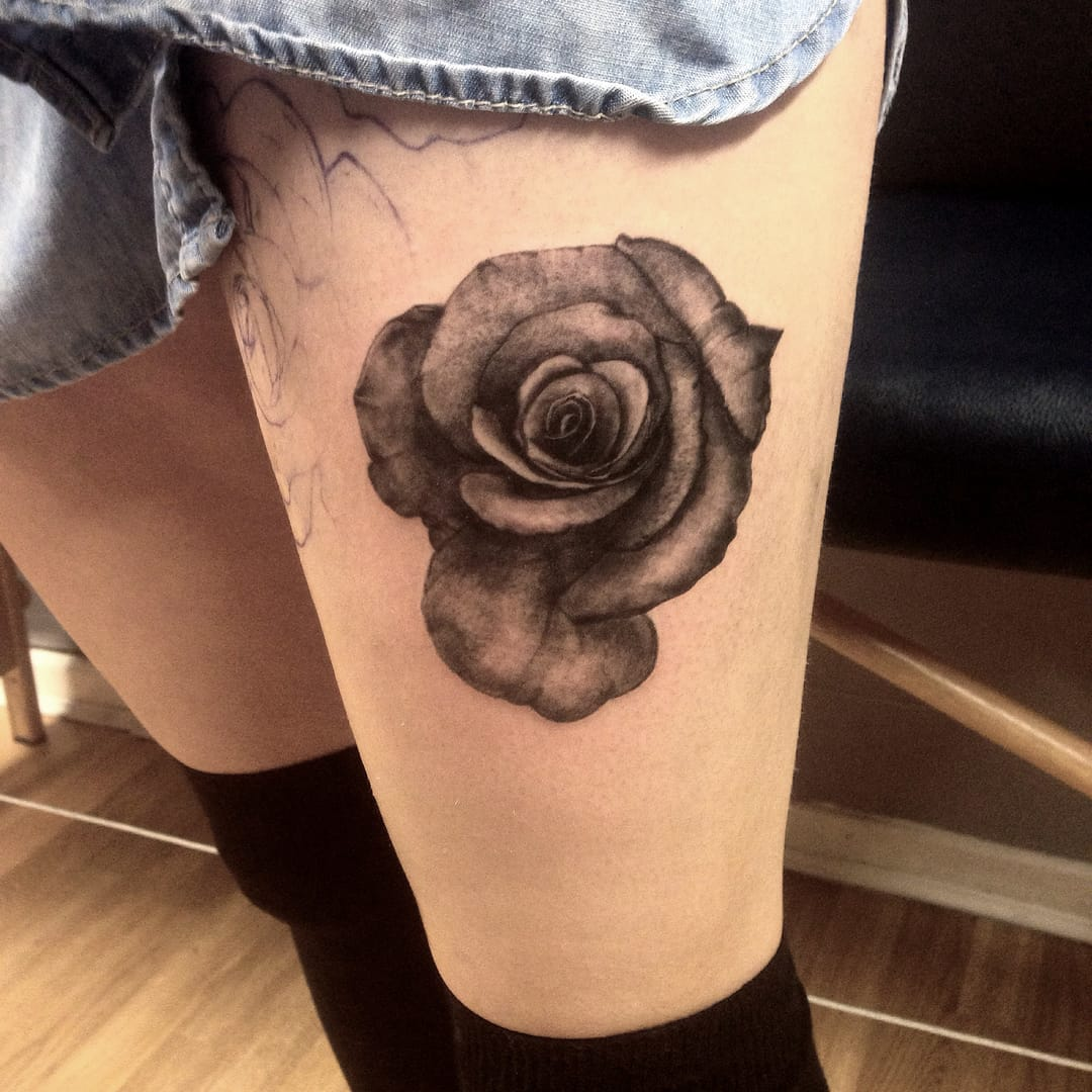 Black and grey rose tattoo by Shaun Williams.
