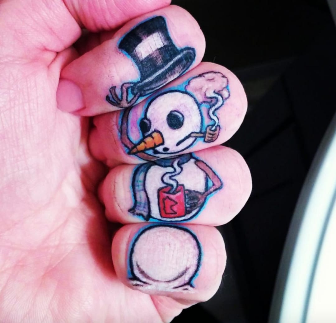 Finger snowman tattoo by Mark Reif at A+ Tattoo in Hastings MN