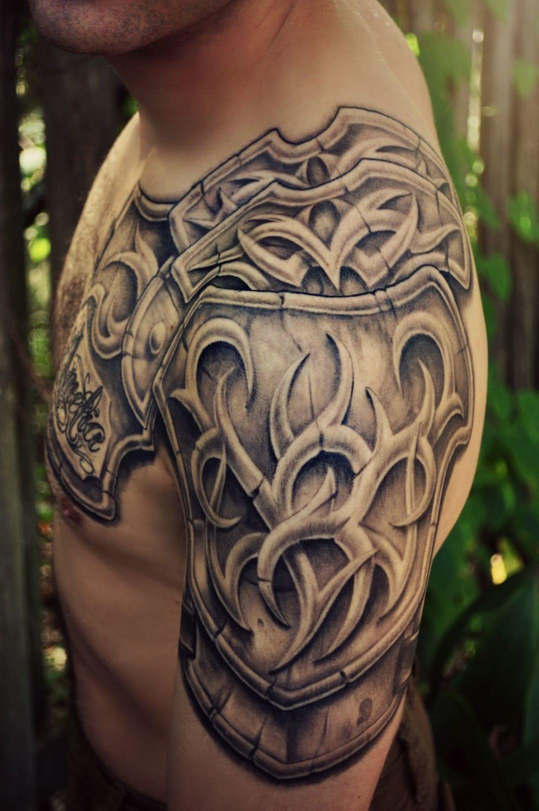 Celtic dragon arm tattoo