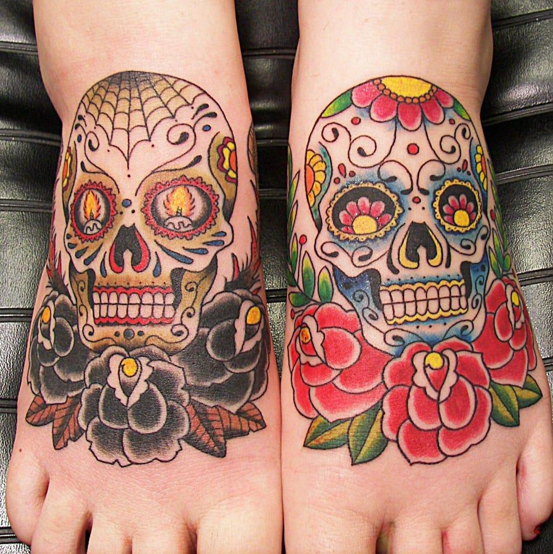 Super cute matching sugarskulls via skullspiration.com #sugarskull #skull #rose #matching #matchingtattoos #pair #pairtattoo #foottattoo