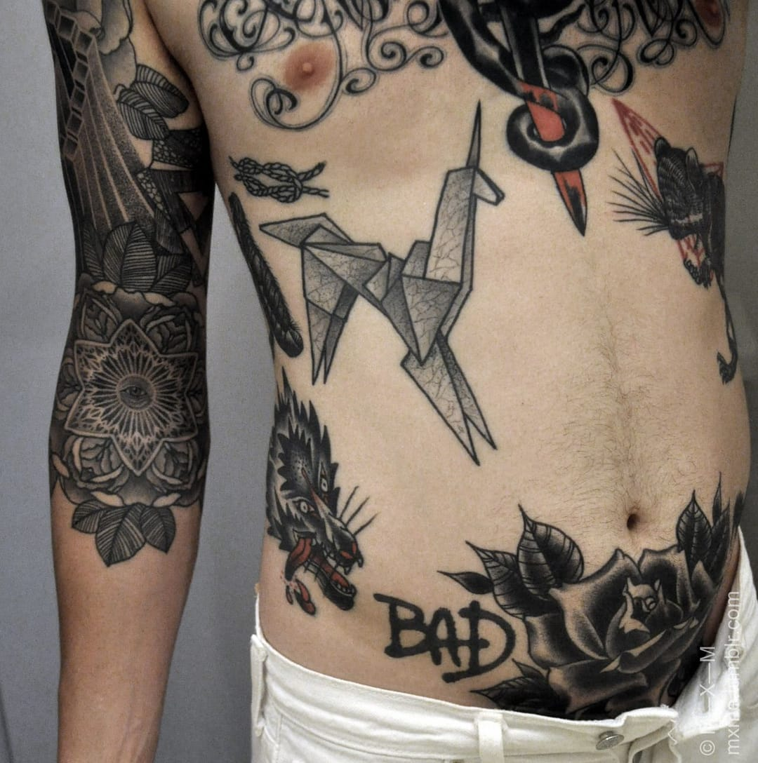 Origami looks great both on men and women. Some sick tattoos here by Maxime Buchi.