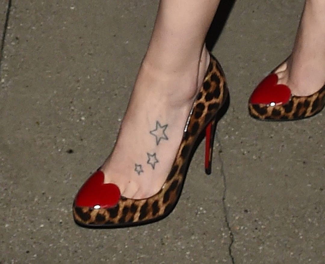Detail on her foot tattoo.