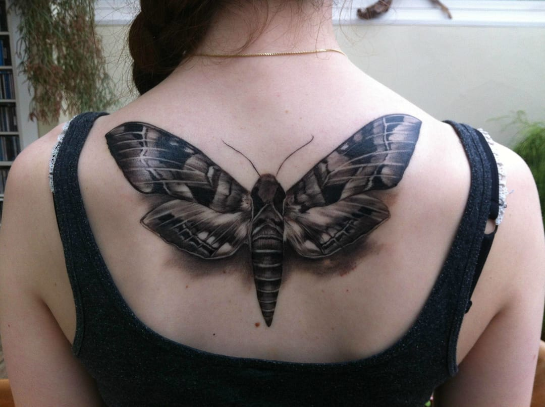 8 Bold Black Moth Tattoos