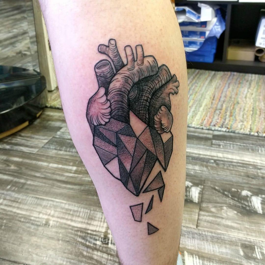 Geometric Heart Tattoo by Logan Bramlett, Wanderlust Tattoo Society