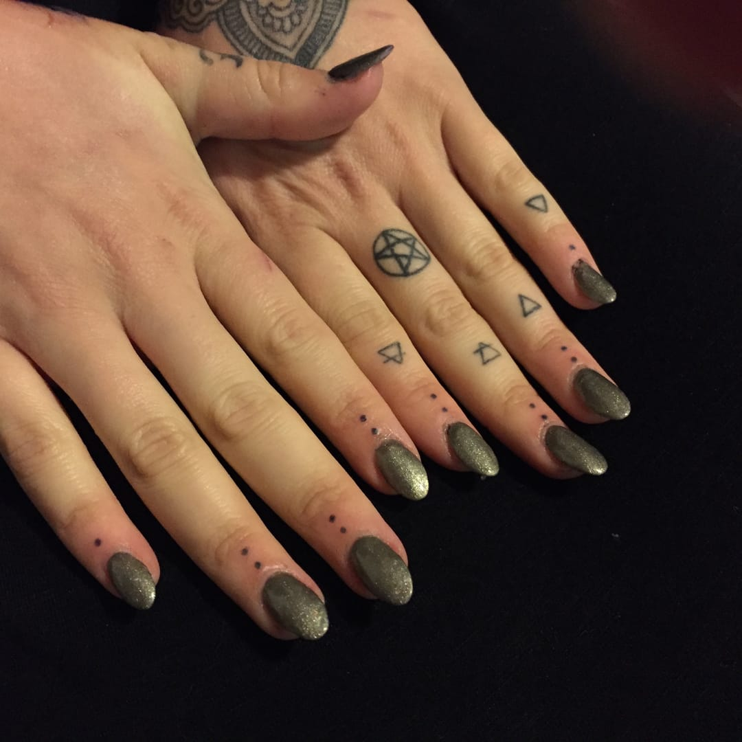 Hand-poked dot tattoos by Mike Love. Pentacle and element symbols healed by Emma Garrard.