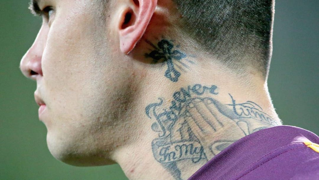 Daniel Vidot from the Brisbane Broncos, praying neck ink, photo by Scott Barbour/Getty Images