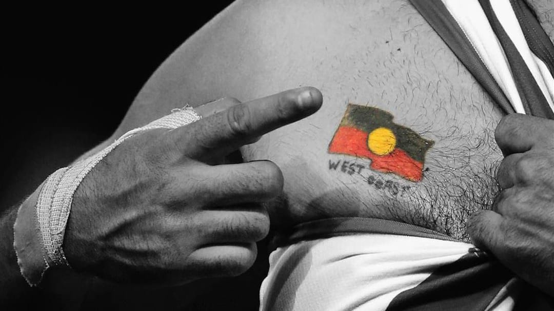 Melbourne Kangaroos player Lindsay Thomas indicates his aborigine flag, Photo by Michael Dodge/Getty Images