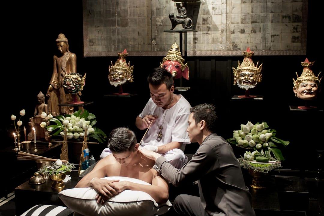 Ajahn Boo tattooing a client. Via Rob Report
