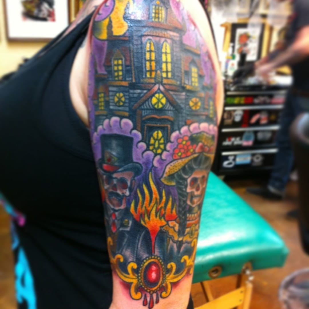 Traditional style haunted house tattoo by Loo Pimble of Mr.Beards in Kington, Herefordshire.