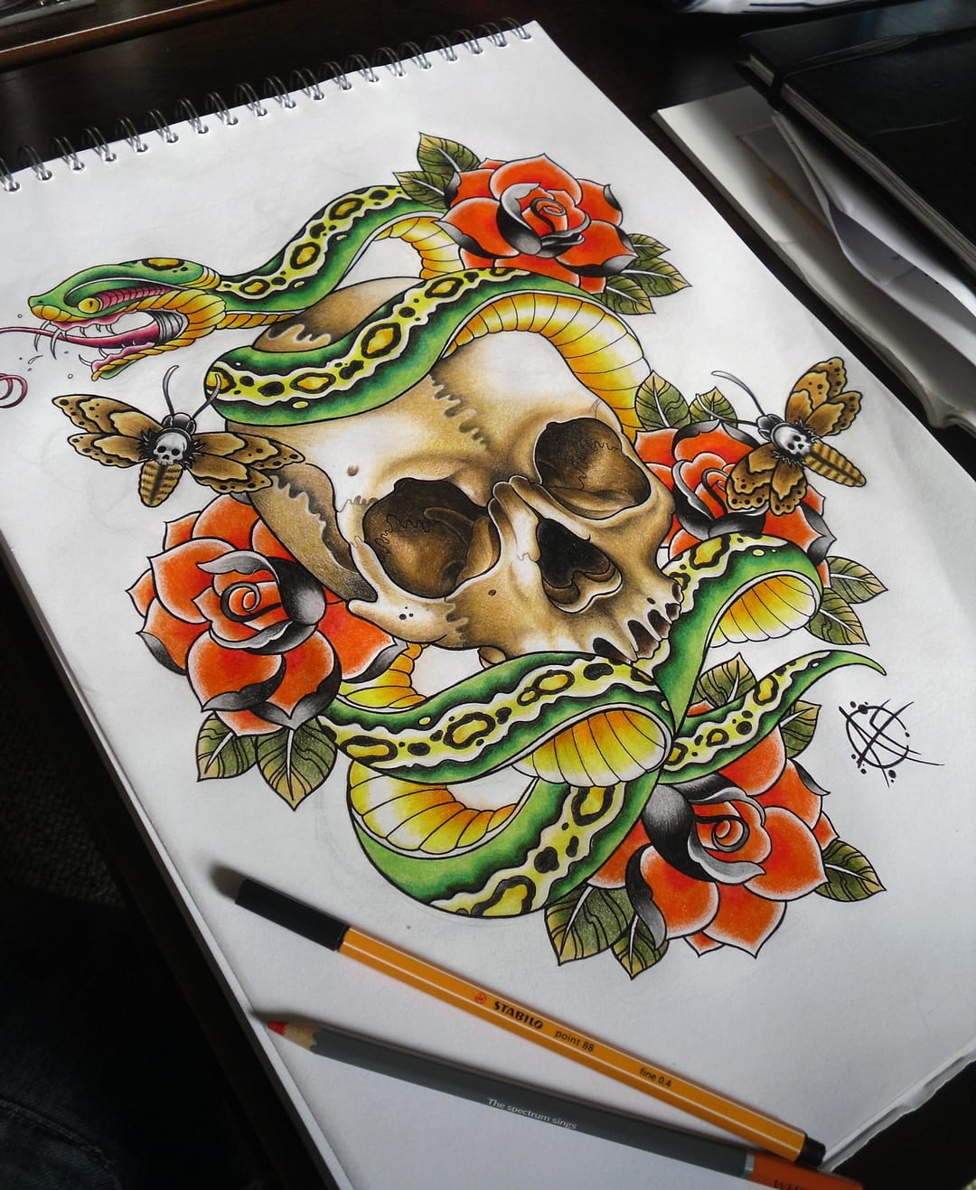 Traditional Snake & Skull design done by Aaron Frost.