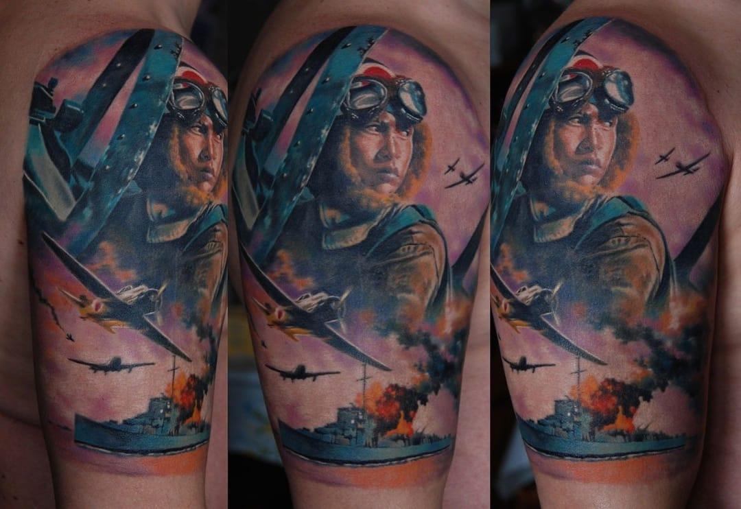 Epic blitz (air raid) tattoo by Den Yakovlev.